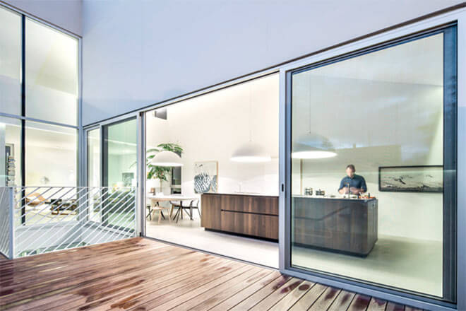 The house's four levels comprise a small square basement, a rectangular ground floor, an L-shaped first floor and a small upper-level mezzanine. Image via T B A