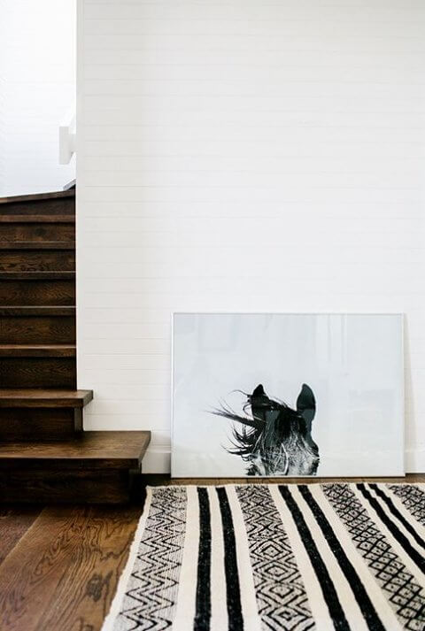 Leaning artwork beside a staircase in your modular home