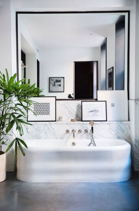 Leaning artwork in the bathroom of in your modular home